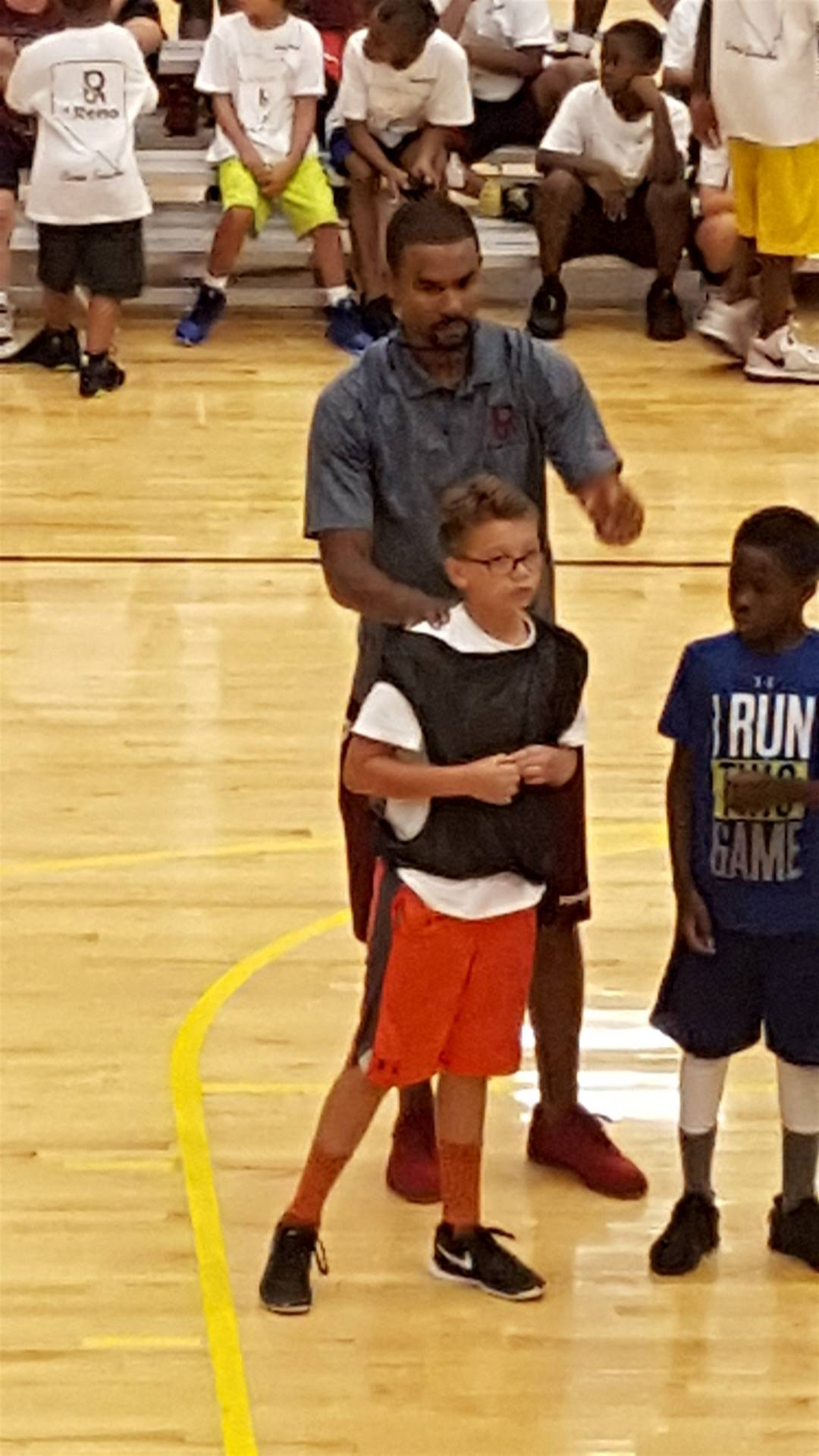 Aiden H. with pro-basketball player Sessions!