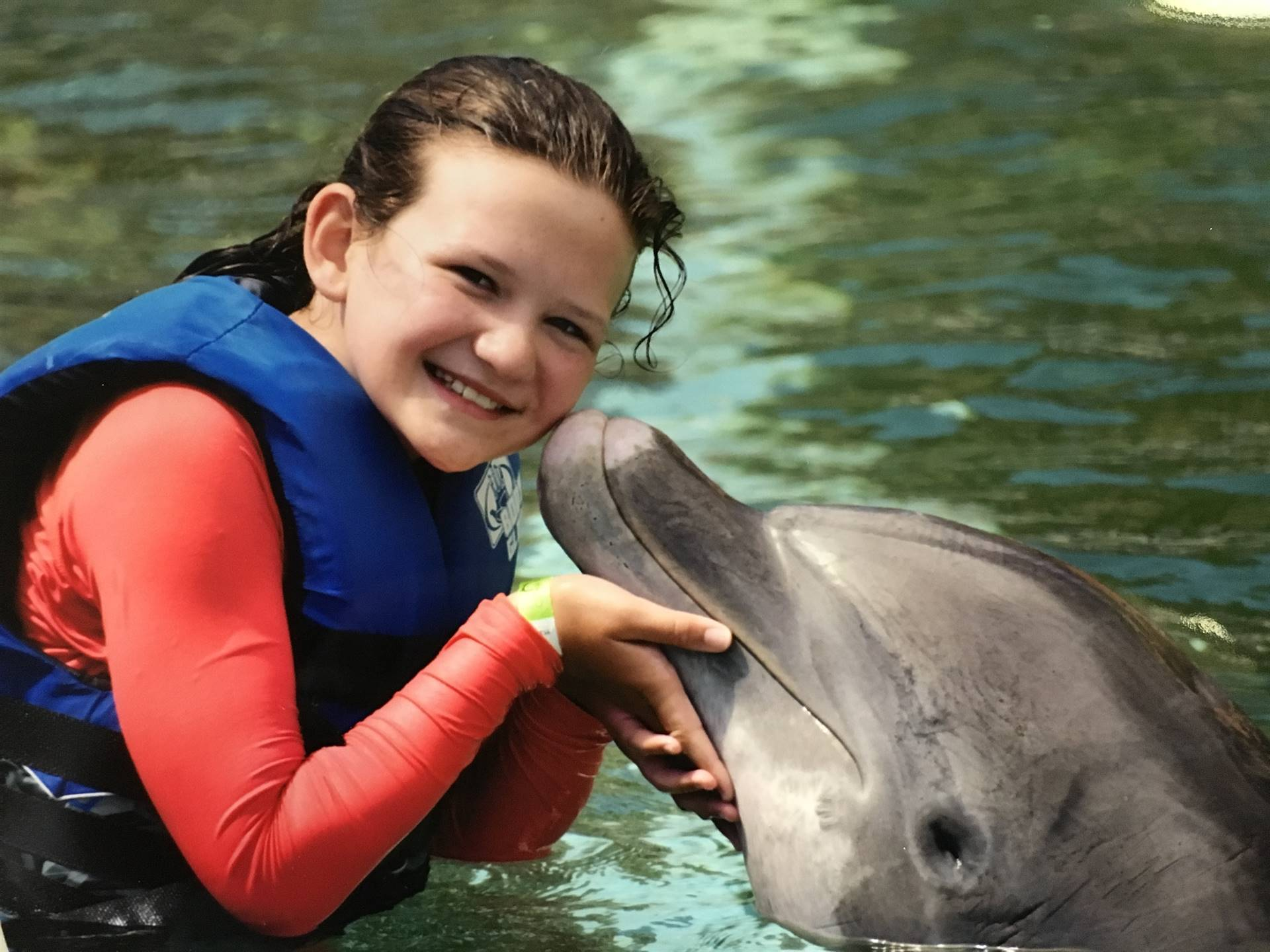 Riley B. swimming with the dolphns in Hawaii!!