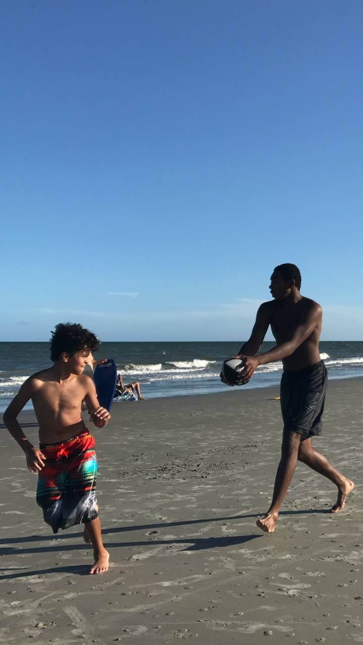 Houston playing football at Hilton Head Island beach